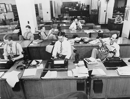 Image of old New York Times newsroom. Your visitors don't want yesterday's news; give them a fresh website design with engaging and updated content.