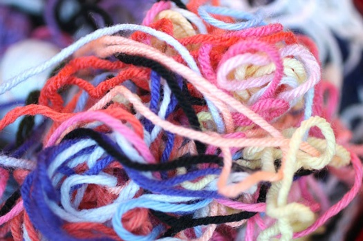 Image of tangled yarn. A/B website testing shouldn't involve untangling a mess of possible threads.