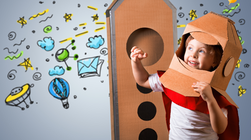 Young boy with rocket ship. Reach for the stars and the future of inbound marketing strategies with automation tools in Detroit.